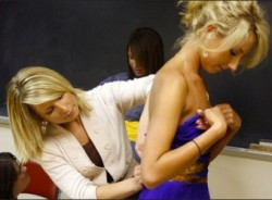 portland fashion institute designer helping model with a fitting